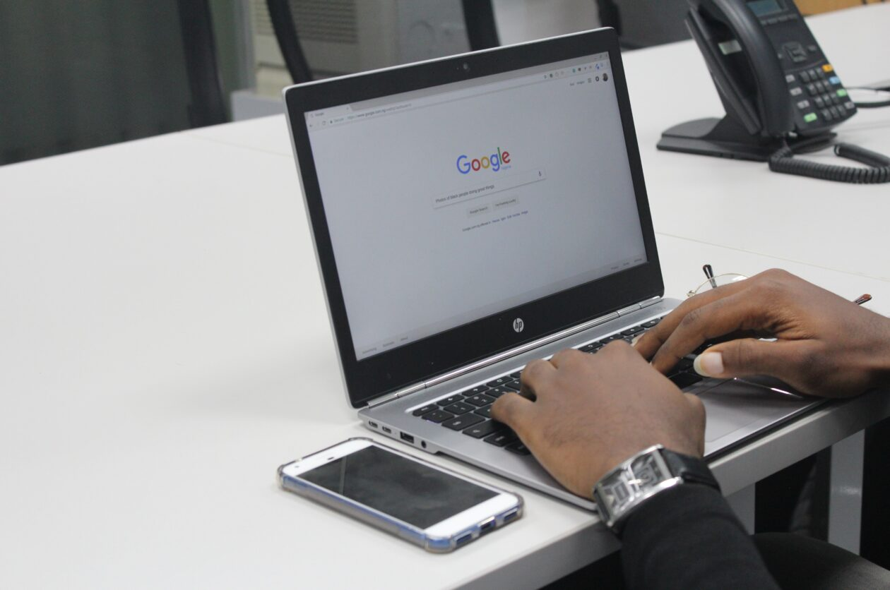 person typing on google